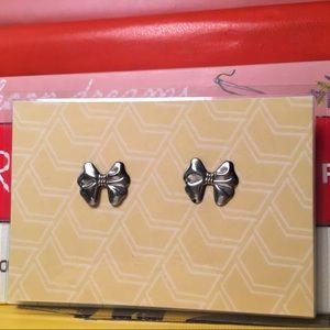 Silver tone bow stud earrings